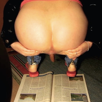 A woman spreads her ass cheeks and takes a large shit onto an open newspaper on the floor. About 2 minutes.